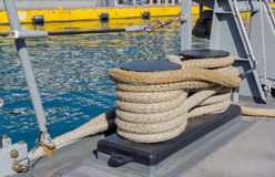 Bollard with ropes on a ship Royalty Free Stock Image