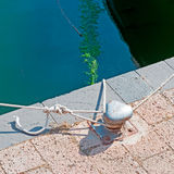Bollard and ropes Royalty Free Stock Photos