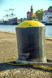 Bollard in a seaport with sailing ship Stock Photo