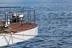 Bollard on ship deck with metal mooring lines. Stock Photos
