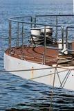Bollard on ship deck with metal mooring lines. Stock Image