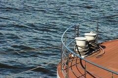 Bollard on ship deck with metal mooring lines. Royalty Free Stock Photos
