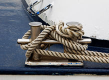Bollard on the ship and tied rope Royalty Free Stock Photography