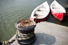 The bollard tied in the harbor Stock Image