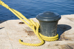 Bollard with yellow rope Royalty Free Stock Images