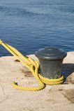 Bollard with yellow rope Royalty Free Stock Photography