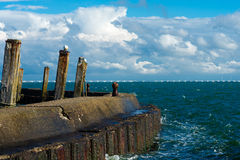 Bollards against a blue sky. Bollards to moor ships in an old harbour Stock Images