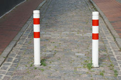 Bollards on city street Royalty Free Stock Photography
