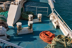 Bollards on the ferry. Bollards and some of nautical ropes on deck of a ferry Royalty Free Stock Photo
