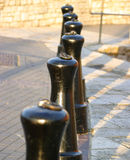 Bollards (selective focus). Selective focus on 2nd bollard, Image taken late in day with long, deep shadows stock photo