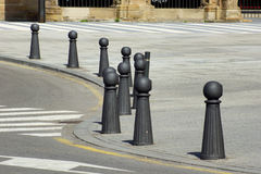 Bollards 1. Several metal grey bollards in the street with sunlight Royalty Free Stock Photo