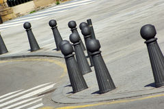 Bollards 2. Several metal grey bollards in the street with sunlight Royalty Free Stock Photos