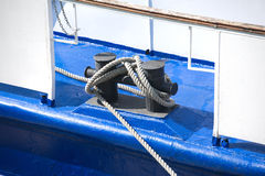 Bollards with thick hemp rope on closeup Royalty Free Stock Photo