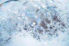 bolle Bianco-blu della schiuma fotografie stock libere da diritti