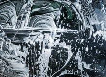 Bolle dell'autolavaggio con sapone Fine in su fotografie stock