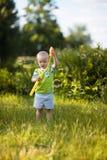 Bolle di sapone di salto del bambino Fotografia Stock Libera da Diritti