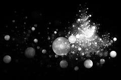 Bolle monocromatiche d'ardore astratte su fondo nero Immagini Stock Libere da Diritti