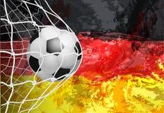 Bollen i netto Tysk flagga med en fotbollboll i ett netto stock illustrationer