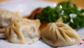 Bollen, Manti - traditionele vleesschotel van Centraal-Azië Royalty-vrije Stock Afbeeldingen