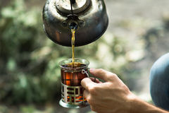 Bollitore e tazza di tè Immagine Stock