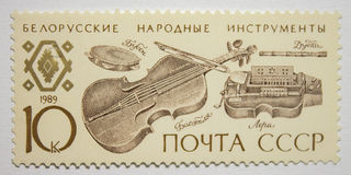 Bollo dell'URSS con il bassotto bielorusso, lera, tubo, tamburino Immagine Stock