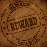 Bollo della RICOMPENSA su carta sgualcita vecchio marrone Fotografia Stock Libera da Diritti