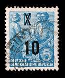Bollo stampato nel GDR, manifestazioni agricoltore, lavoratore, intellettuali Fotografia Stock