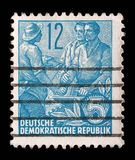 Bollo stampato nel GDR, manifestazioni agricoltore, lavoratore, intellettuali Immagini Stock Libere da Diritti