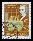 Bollo stampato in Ungheria, manifestazioni George Stephenson e sua locomotiva a vapore fotografie stock libere da diritti