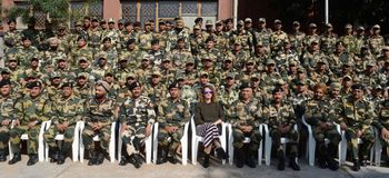 Bollywood actress Kangna Ranaut with soldiers during a visit to BSF`s Paloura camp in Jammu Stock Photo