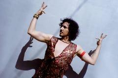 Bollywood dancer with beard and black curly hair royalty free stock photos