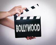 Bollywood. Female hands holding movie clapper. White background Stock Images