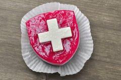 Bolo com bandeira de Suisse fotografia de stock