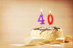 Bolo de aniversário com vela ardente como um número quarenta Fotografia de Stock Royalty Free