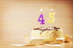 Bolo de aniversário com vela ardente como um número quarenta e cinco Fotos de Stock Royalty Free