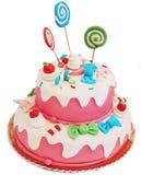 Bolo de aniversário cor-de-rosa imagens de stock