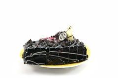 Bolo de aniversário saboroso dos pedaços de chocolate isolado no fundo branco Fotos de Stock Royalty Free