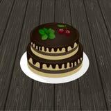 Bolo de chocolate de dois níveis do biscoito com ramo da hortelã e cerejas em uma placa textura de madeira no fundo Fotografia de Stock Royalty Free