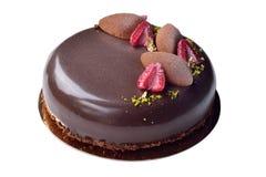 Bolo de chocolate extravagante com as framboesas decoradas Fotografia de Stock Royalty Free