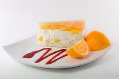 Bolo de queijo com geleia alaranjada Imagem de Stock