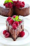 Bolo de queijo do chocolate com framboesas Fotografia de Stock