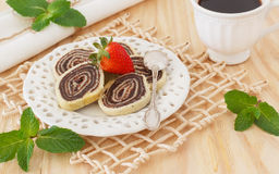Bolo de rolo (swiss roll, roll cake) Brazilian chocolate dessert Royalty Free Stock Image