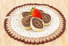 Bolo de rolo (swiss roll, roll cake) Brazilian chocolate dessert Stock Photos