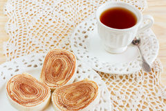 Bolo de rolo (swiss roll, roll cake) Brazilian dessert cup tea stock photo