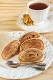 Bolo de rolo (swiss roll, rollcake)  Brazilian dessert with cup Royalty Free Stock Images