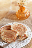 Bolo de rolo (swiss roll, rollcake) Brazilian dessert on white royalty free stock photography