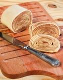 Bolo de rolo (swiss roll, rollcake)  Brazilian dessert on wooden Royalty Free Stock Image