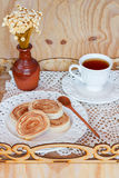 Bolo de rolo (swiss roll, rollcake) dessert cup of tea on tray Stock Images