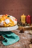 Bolo do Rei or King`s Cake. Made for Christmas, Carnavale or Mardi Gras with Present Wrapping in Background Royalty Free Stock Photo
