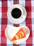 Bolo e café alaranjados Fotografia de Stock
